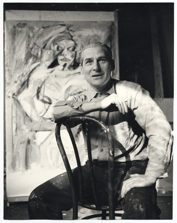 <p>Willem de Kooning with a state of <em>Woman I</em>, c. 1952</p>