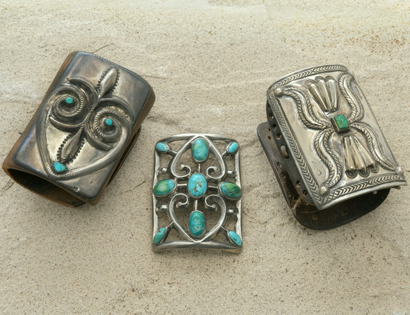Three Navajo bow guards with turquoise details