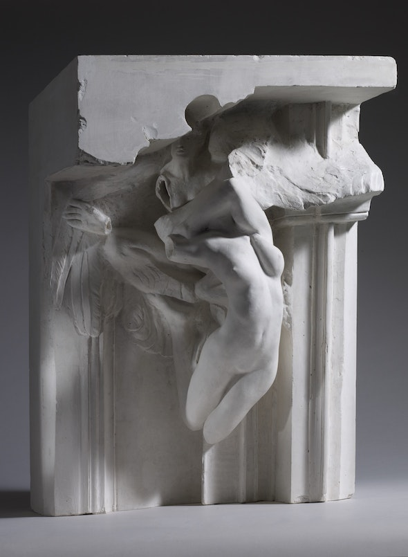 A Rodin sculpture in which a headless female form appears to emerge from the upper part of a doorframe.