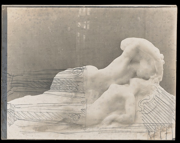 Architectural elements are sketched atop a gelatin silver print of a sculpture of a man and woman.