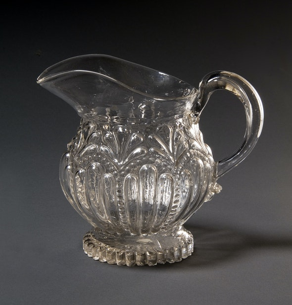 <p>This glass pitcher can be found in Braun's cupboard. </p>