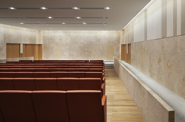 The Comcast Auditorium features limestone walls and leather seats.