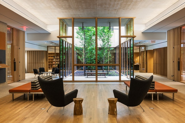 In the Lower Lobby Suite, two cozy leather chairs overlook an open-air atrium.