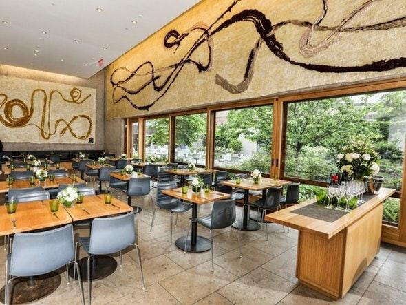 The Garden Restaurant overlooks a leafy courtyard.