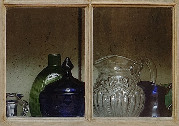 <p>A close look through the window of Braun's cupboard reveals our mold-blown glass pitcher.</p>