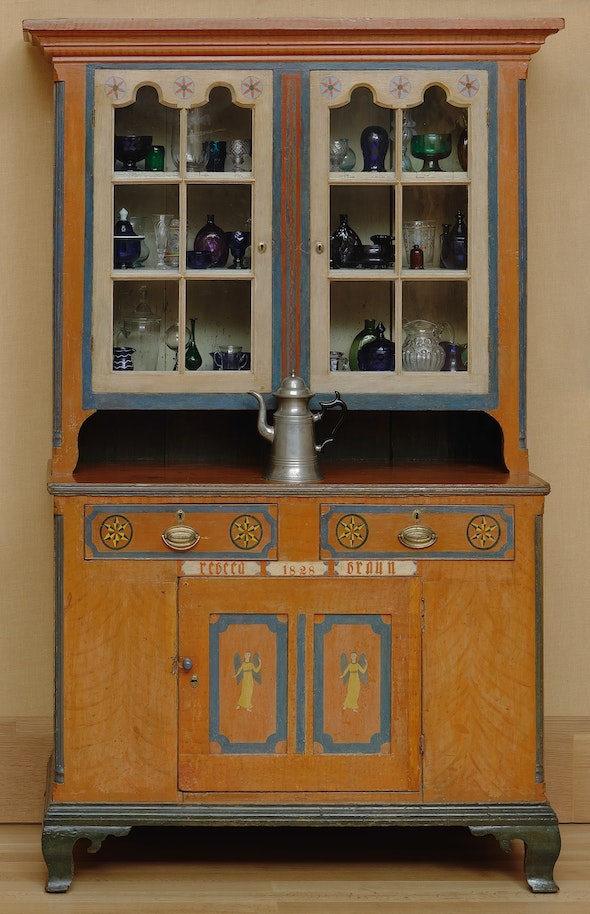 <p>This 1828 cupboard by Pennsylvania German cabinetmaker Michael Braun is packed with early American glass.</p>