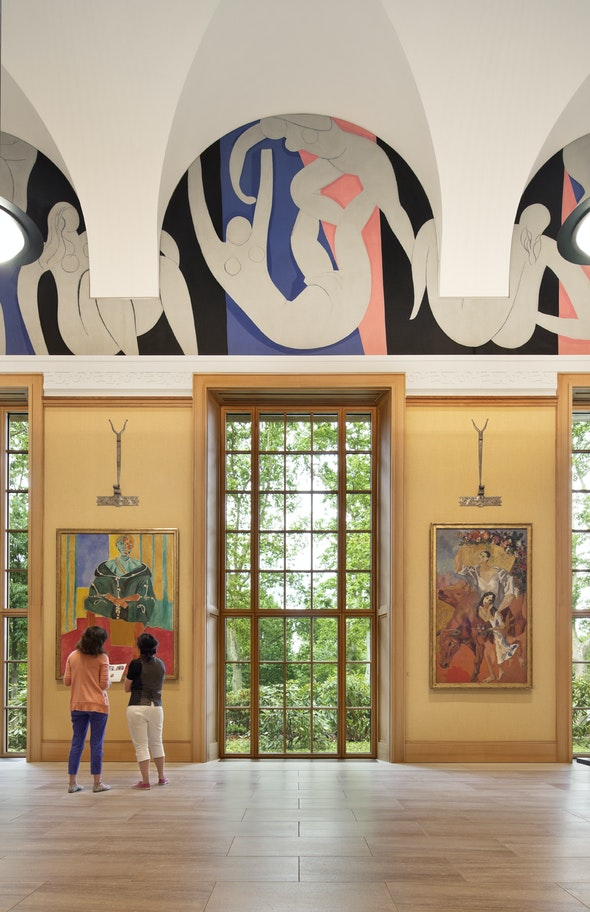 A window streams light into a gallery at the Barnes Foundation.